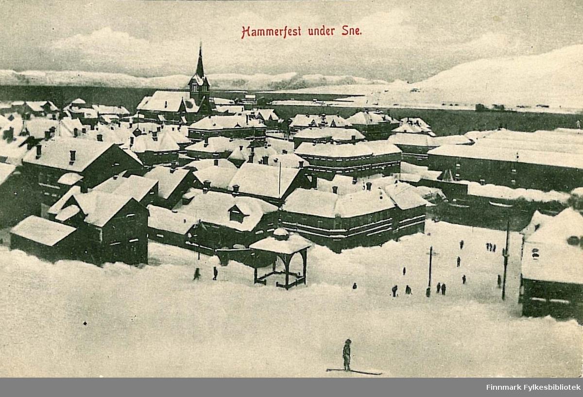 Postkort med motiv av et vinterkledt Hammerfest. Kortet er en julehilsen og er sendt fra Hammerfest til Kirsten Buck på Hasvik i 1908.