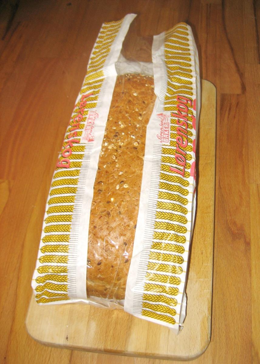 Motivet er en bort med kornaks langs posens kantsider