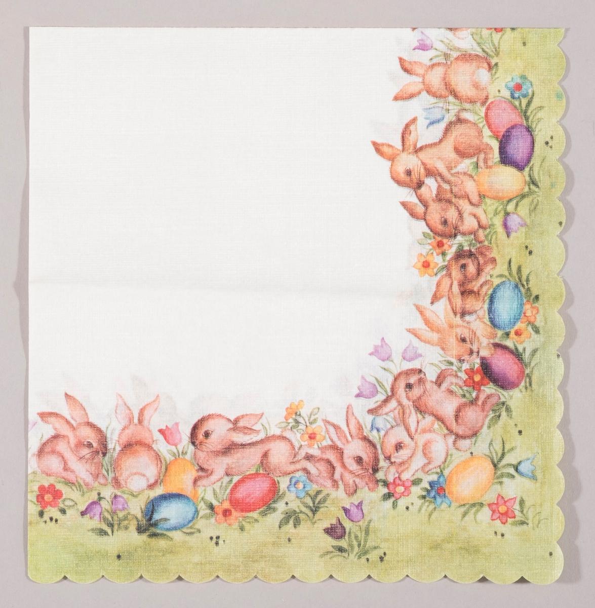 Mange påskeharer i en blomstereng med kulørte påskeegg og blomster i mange farger