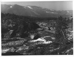 Elva fra Grotli soomm renner i Vuluvatnet, Skjåk
