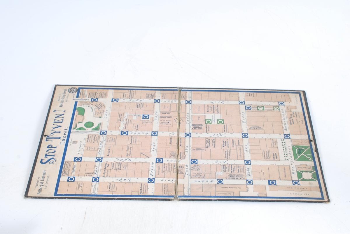 Selve brettspillet: Utformet som et kart over sentrum av Kristiania, med Karl Johans gate og de øvrige gatene ned mot havna og Vippetangen. På forsiden: Siluettegning av en mann ( tyven ) som løper i full fart foran to politimenn, en penkledd herre, to katter og en hund. En som ser ut som en av byens løse fugler har i forbifarten gått ned for telling på ryggkulen.