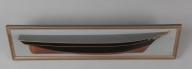 Halvmodell av skip bygget av skipsbyggmester Ananias Dekke (1832-1892). Modellen har i sin tid vært forært til brukseier P. Arnold Hansen, 1922 av Kristian S. Dekke (se baksiden av modellen). Gave til verksmester Taavig Horten (?) fra P. Arnold Hansen januar 1926. Gallionsfigur er en dame med oppsatt hår.