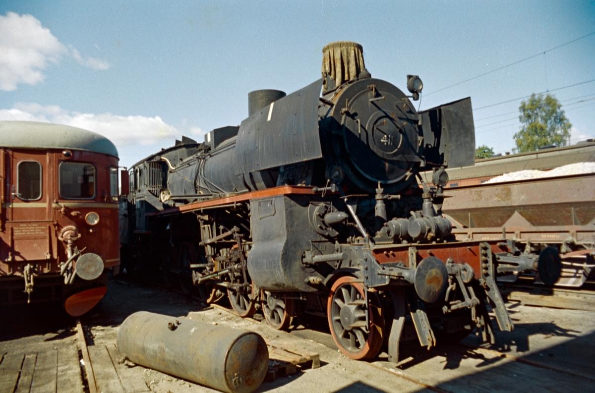 Damplokomotiv type 26c nr. 411 hensatt på Hamar.