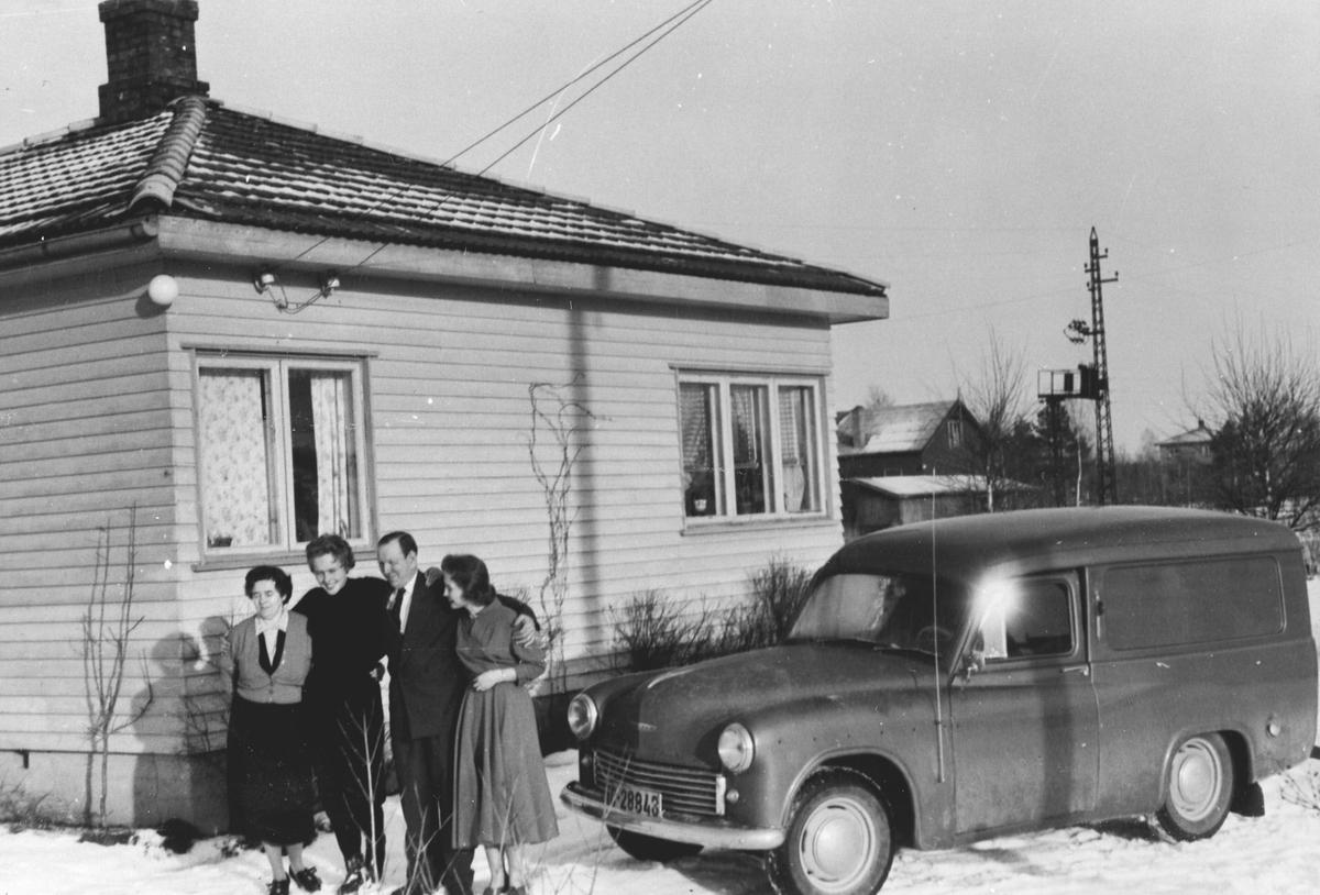 Familien, huset og bilen.